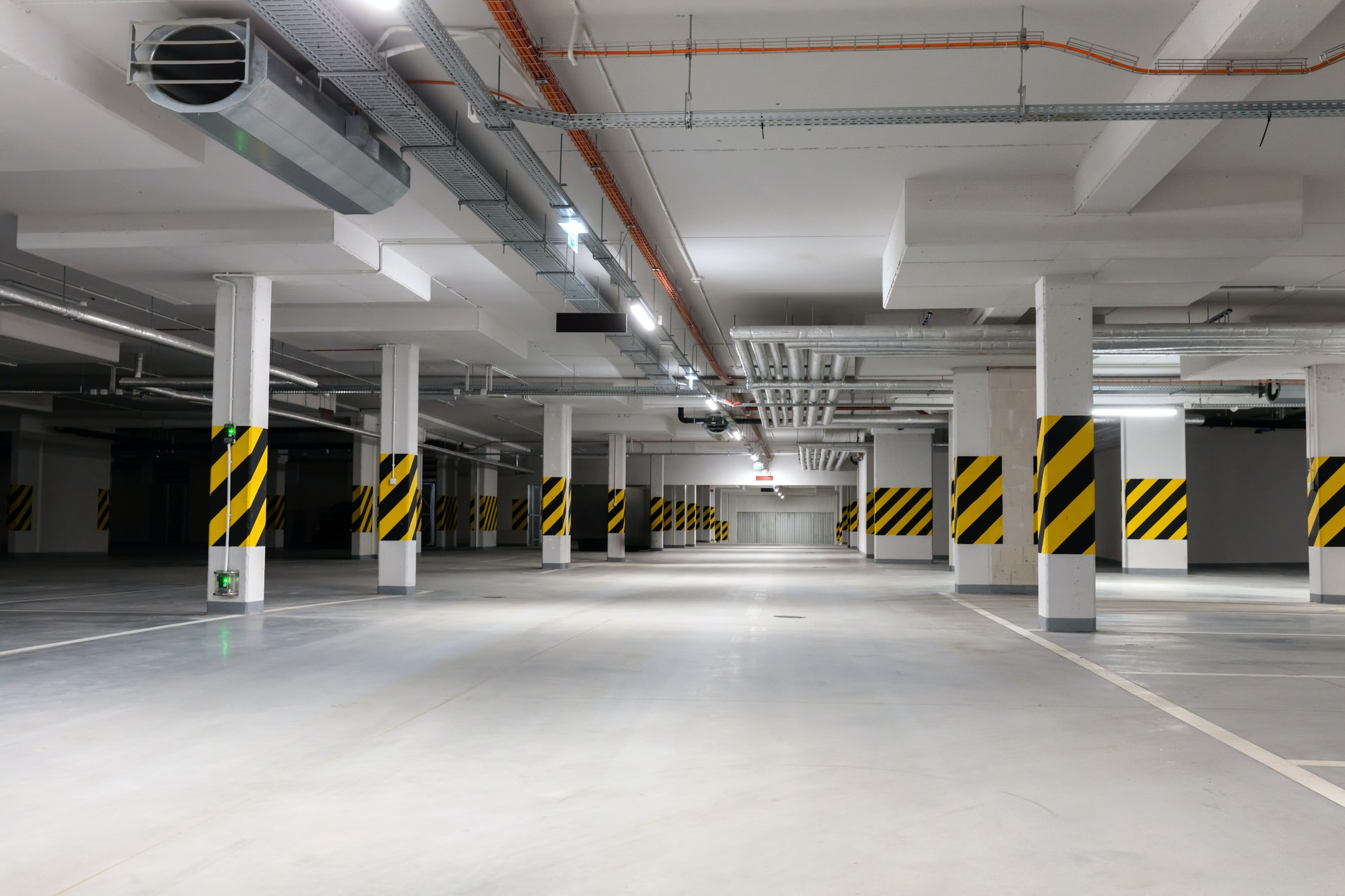 Underground empty parking garage. Modern urban space